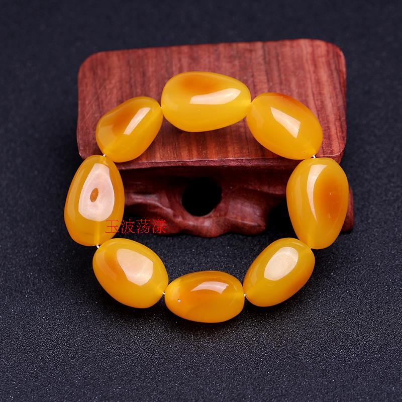 The auction will end @ chicken oil yellow beeswax beads with men and women old stone drum shaped Amber Bracelet 5230 Q