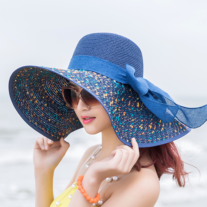 A young female professional student skin sunscreen cap full UV folding beach