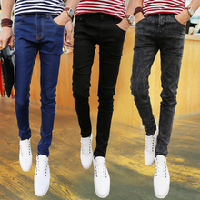 The fall of new men's Stretch Jeans male teenager slim pants male Korean tight jeans tide