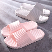 Women's home with a pair of home appliances in the bathroom with a bath indoor anti slip plastic cool slippers