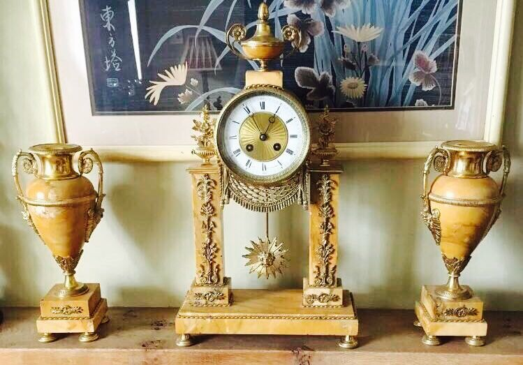 In nineteenth Century the French fine copper gilt marble clock three piece has been in the country