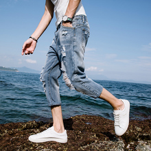 jeans men's pants summer thin section students Slim Korean version of the trend of loose holes 乞丐 7 points shorts men