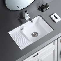 The built-in ceramic laundry basin with a slab laundry pool and a basin laundry sink