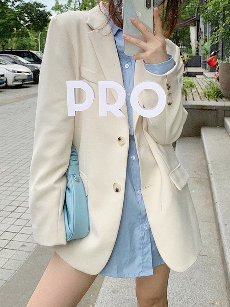 Online red age-reducing fried street high-end sense white small blazer women 2021 spring and autumn loose casual suit top