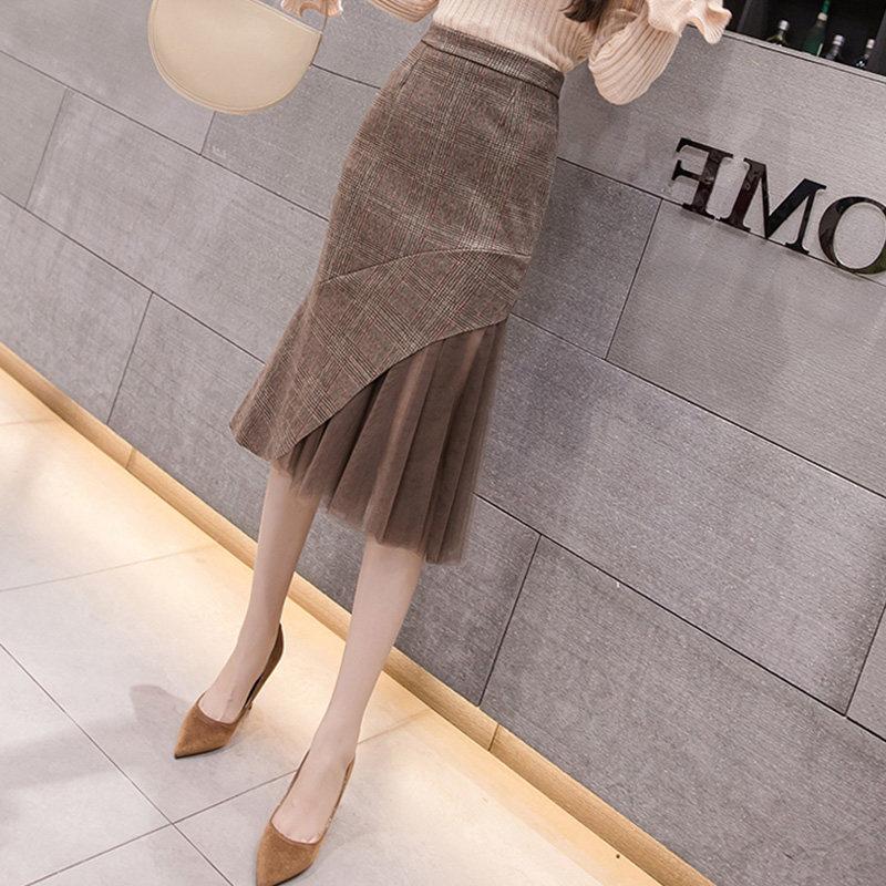 Skirt autumn and winter women 2020 new a-word high waist thin medium-length version of irregular fork bag hip fishtail long skirt