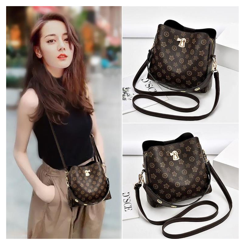 Hong Kong fashion bag girl 2021 new stiletto bag old flower autumn and winter high-capacity one-shoulder air bucket bag