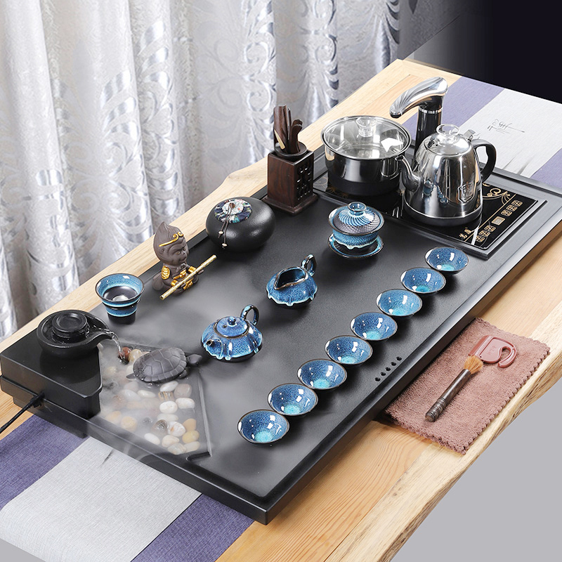 The whole set of Wujin stone tea sets home kung fu tea plate living room simple purple sand atomized flowing teapot fully automatic