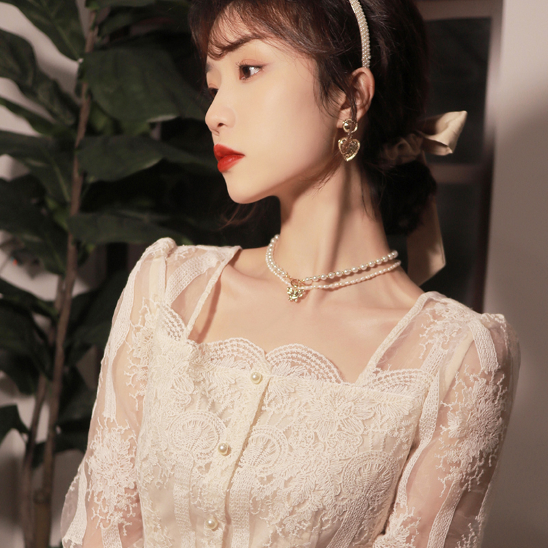 French ancient lace top 2021 early spring new side collar embroidered high-end long-sleeved shirt can be worn solely