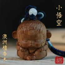 Australian sandalwood small orangutan hand piece Solid wood text play portable plate play carving crafts Car key pendant