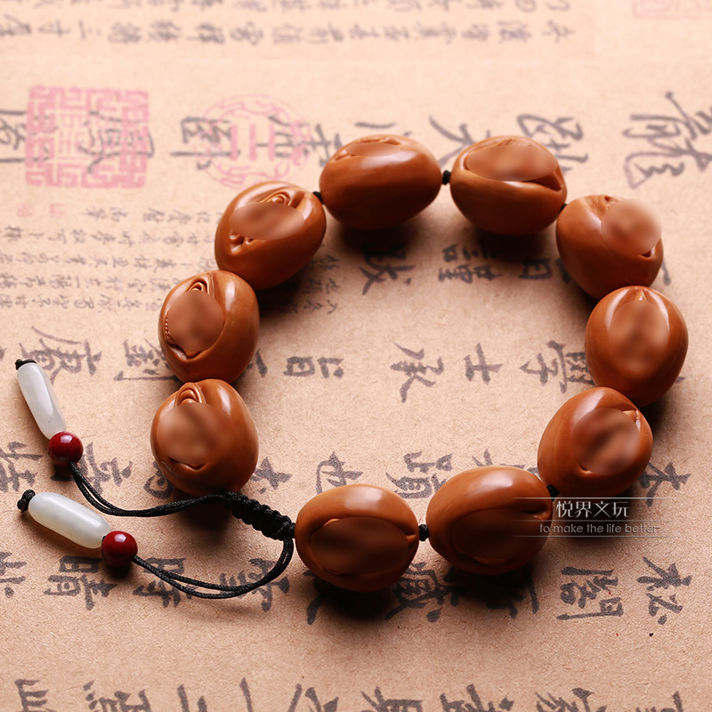 Olive core carving string of the source of life all-yin large hand-carved men and women play iron seed life door hand錬