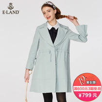 Spring-fresh mint-green light in the long trench coat