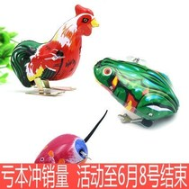 On the spring of childrens toys toys small frog jumping frog will run will move childrens baby large iron Chick
