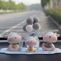 Shaking his head doll calf car ornaments car cute car decoration supplies Creative high-end car center console woman