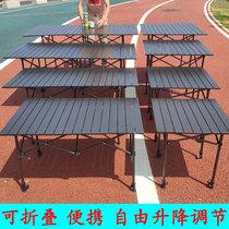 En plein air Table pliante peut être livraison à ascenseur en alliage daluminium nuit marché décrochage table portable simple rectangulaire table à manger et chaise