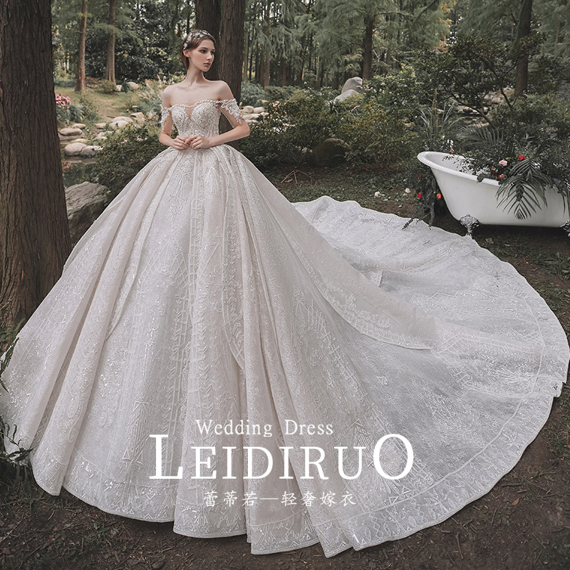 Can be French one-word shoulder long-sleeved autumn and winter main wedding dress 2020 new bride temperament drag-tailed small dress
