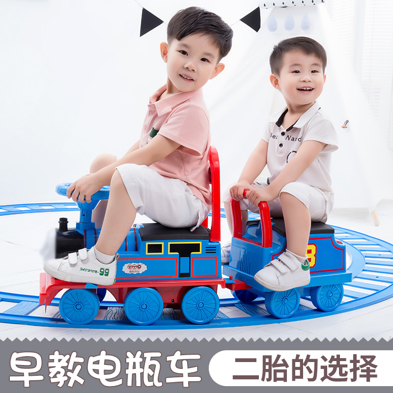Can sit on the human electric small locomotive set track four-wheeled car children shake sound toy male girl 2-3 years old 4
