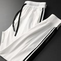 一丝清凉 夏季侧边条纹拼接白色潮流运动裤 男士帅气显年轻小脚裤