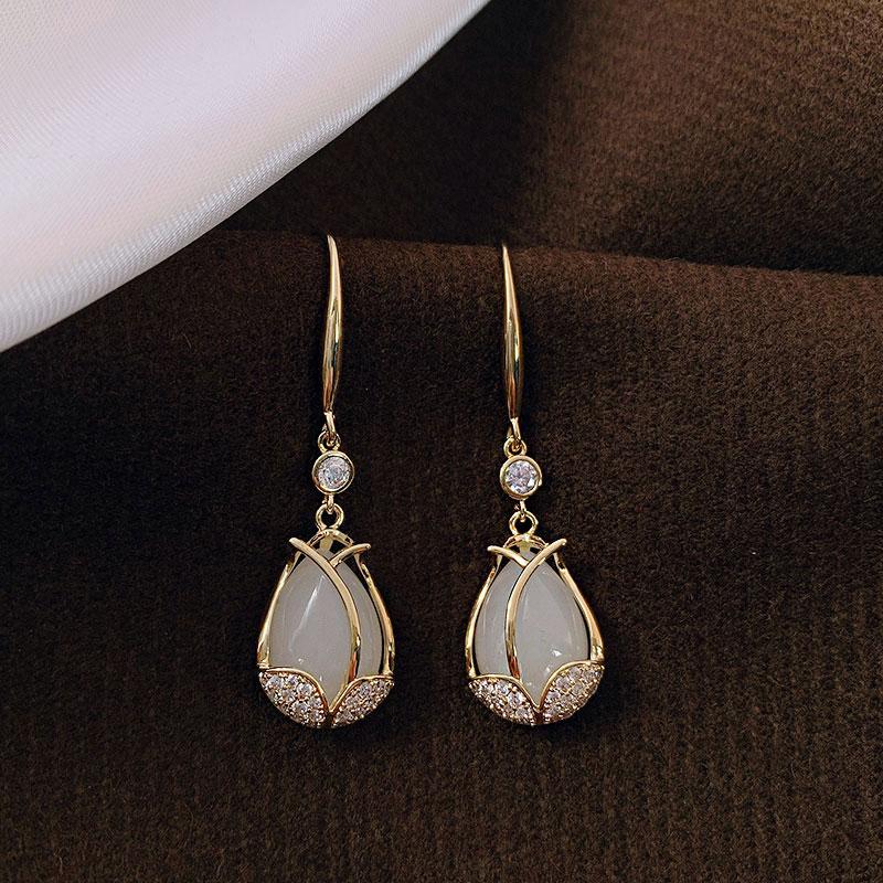 Tulip cat-eye stone earrings womens silver 2021 new trendy atmospheric temperament niche design sense advanced ear hook
