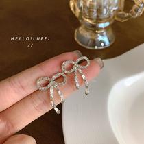 Light luxury exquisite bow stud earring high sense of South Korea web celebrity temperament minority design cold wind earring women