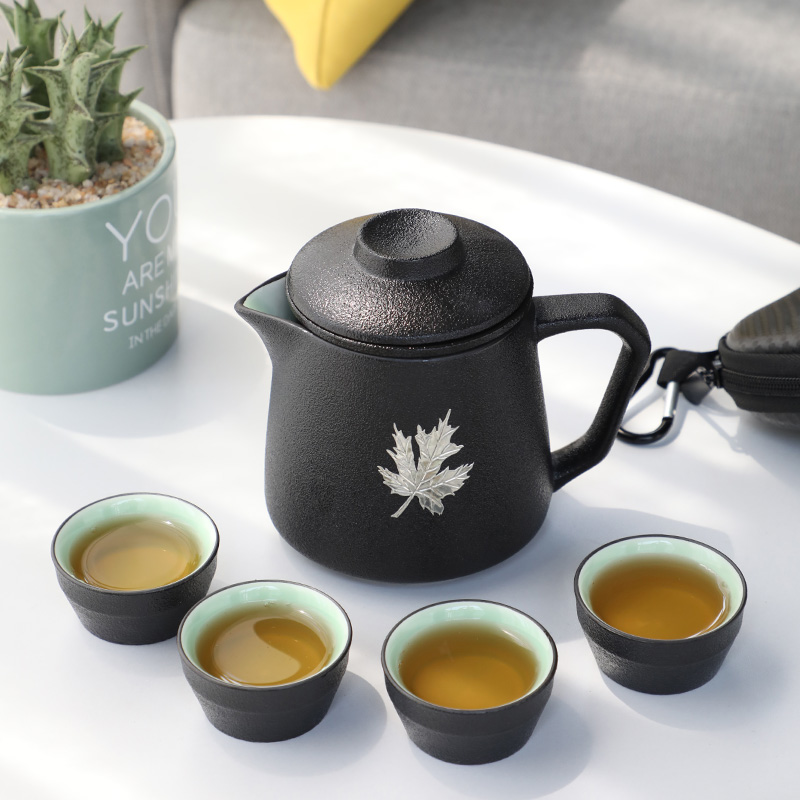 Xin Fulong set travel kung fu tea set portable black pottery quicks cup a pot of four cups two cups simple outdoor