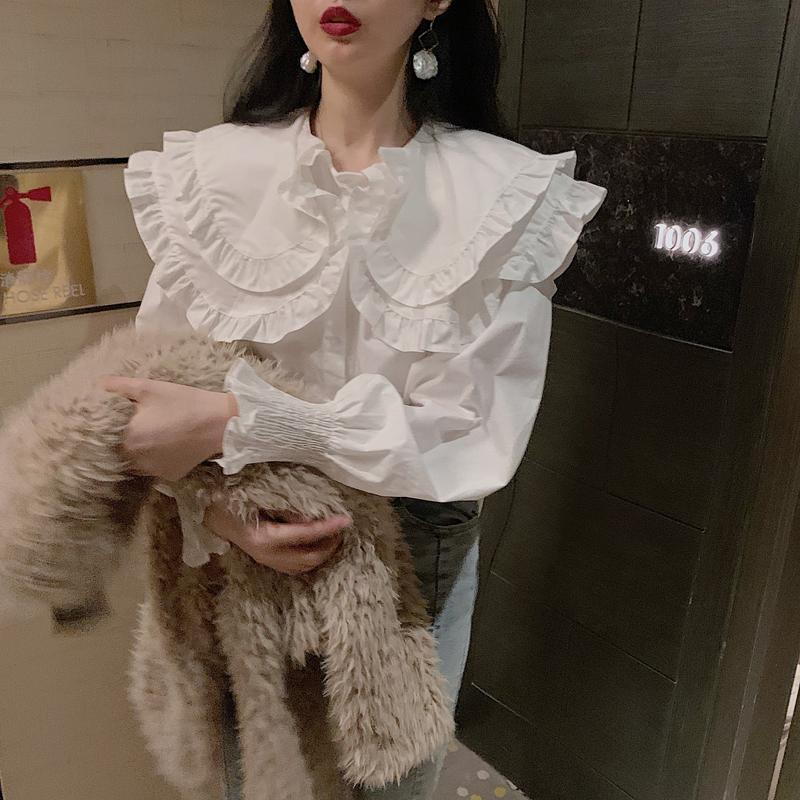 2021 Spring dress new white doll collar shirt female design sense small crowd long-sleeved bottom shirt with top girl