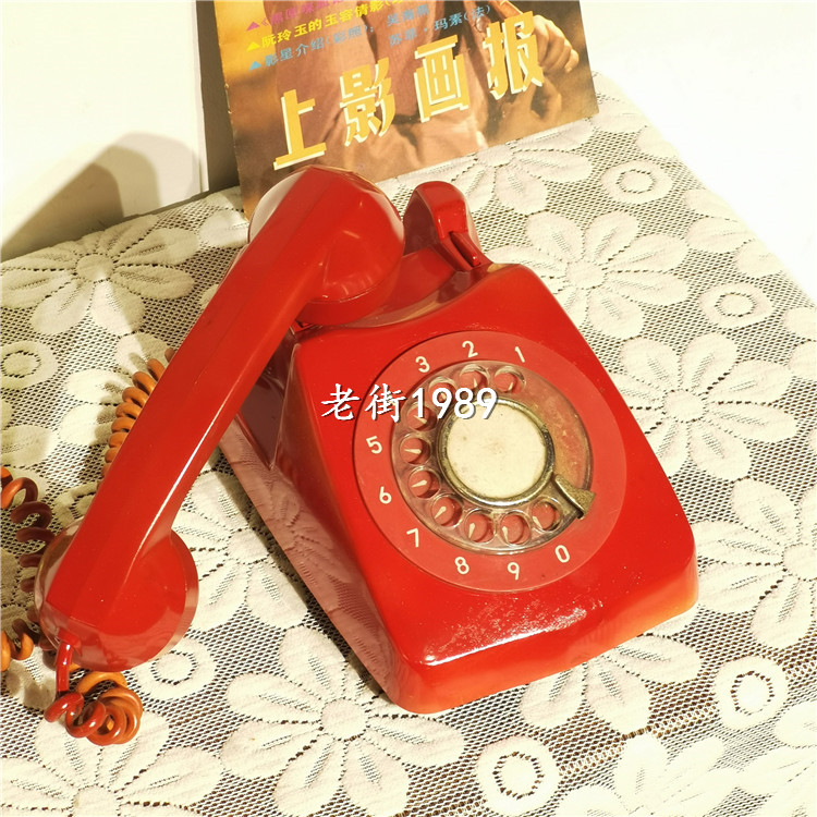 Vintage second-hand old phone red old dial telephone ancient photo prop ornament decoration