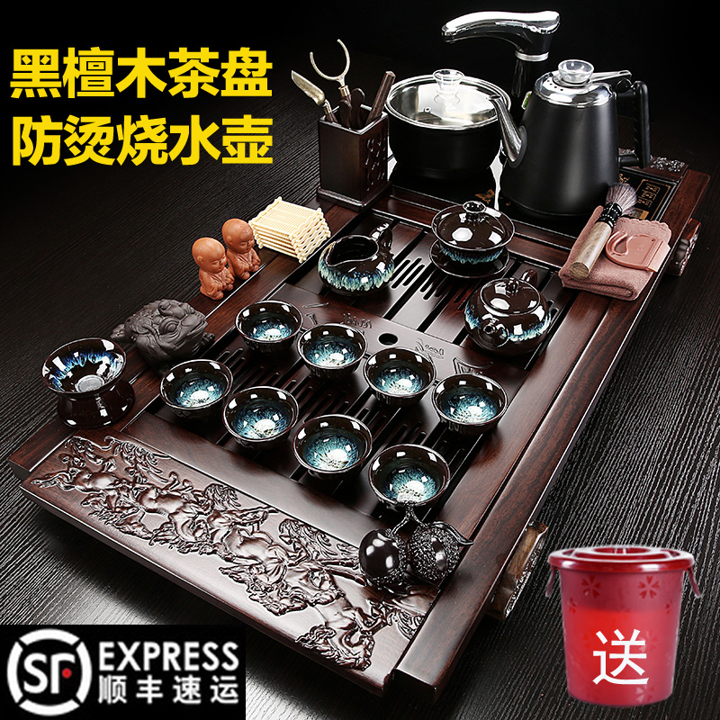Ebony solid wood tea plate home tea set kung fu office tea table set of all-in-one automatic anti-hot electric heat stove