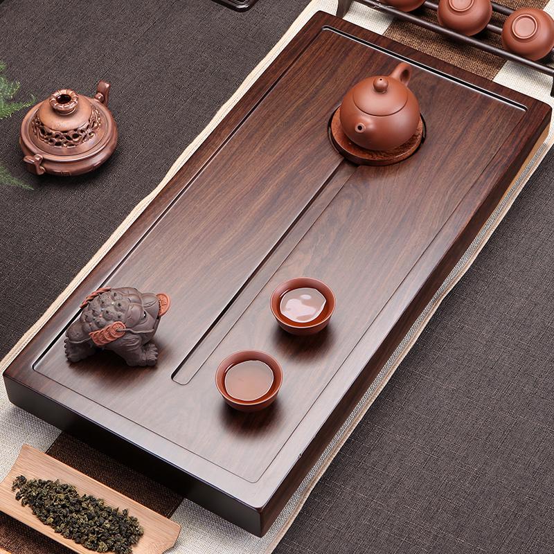 The whole ebony tea plate home kung fu tea set simple solid wood tea table Wujinshi tea to flower pear wood tea sea