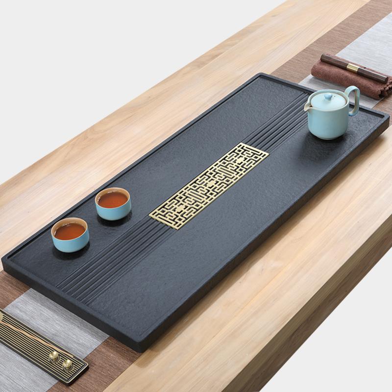 Natural wujin stone tea plate whole piece of household simple stone tea table size stone tea sea kung fu tea set